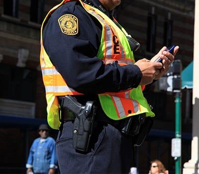 Police officer holding smartphone